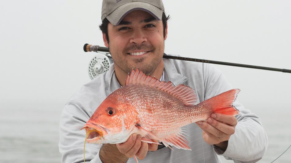 Brandon Finnorn holding a fish