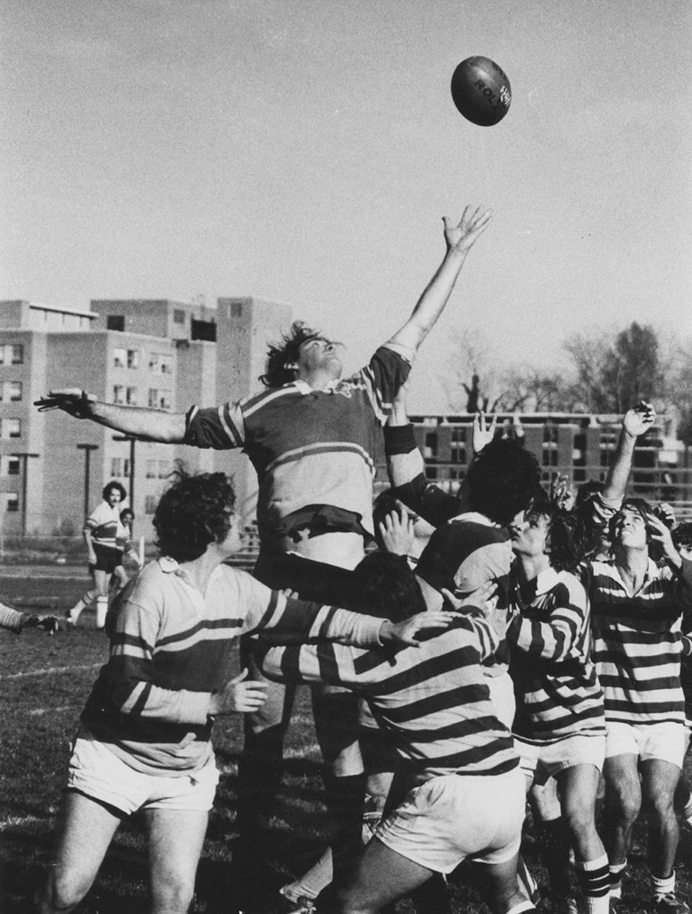 Winston Groom playing rugby with friends