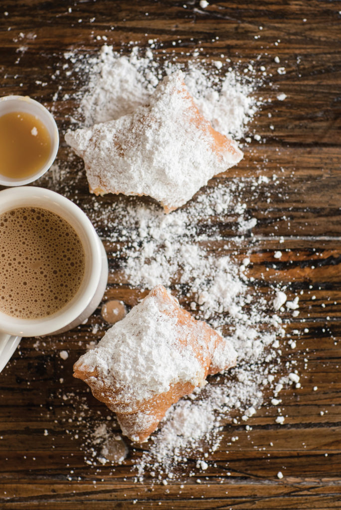 Beignets scattered on a table at Mo'Bay Beignet